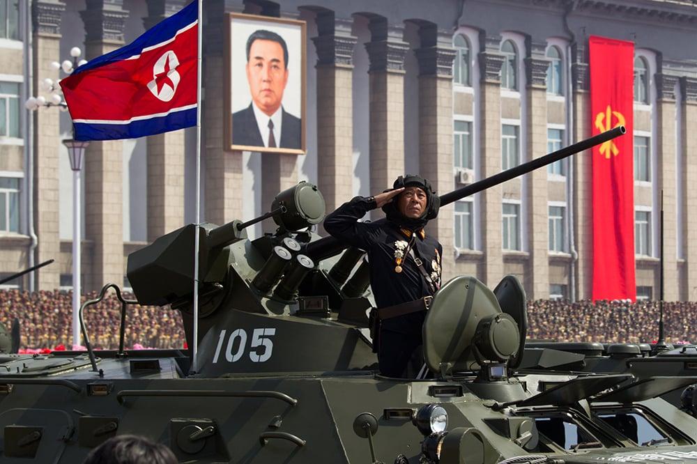 A North Korean soldier salutes atop his